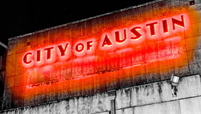 City of Austin glowing red art deco downtown lights