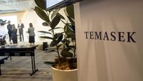 Signage for Temasek Holdings Pte. is displayed during a news conference following the company's annual review in Singapore on July 9, 2019.