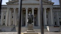 A statue of Albert Gallatin, former U.S. Treasury secretary, stands outside the U.S. Treasury building in Washington.