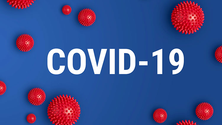 Inscription COVID-19 on blue background with red strain model of coronavirus stock photo
