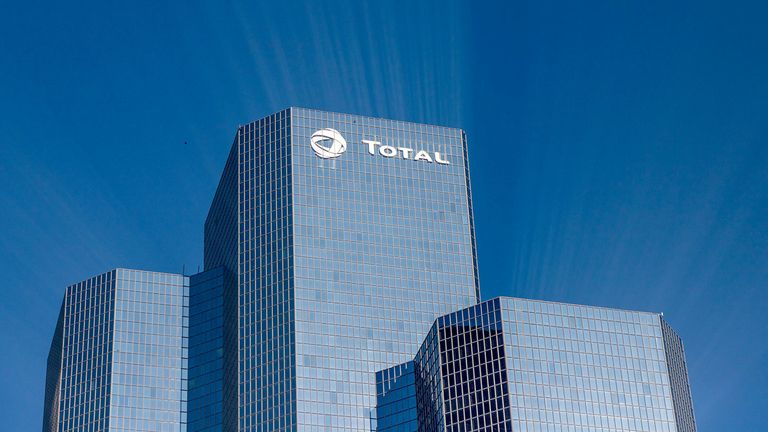 A logo sits on the exterior of the Total SA skyscraper headquarters in the La Defense business district in Paris, France, on Wednesday, Jan. 22, 2020.