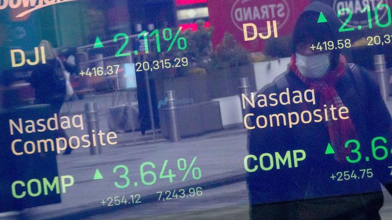 Stocks post third straight gain with stimulus near