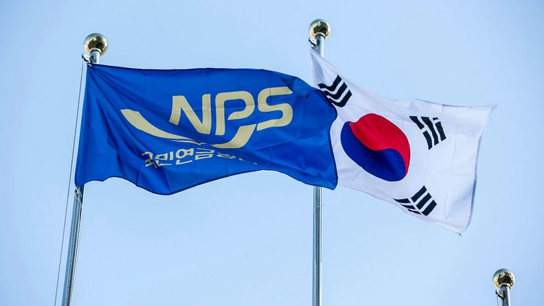 The flags of South Korea, right, and its National Pension Service fly outside the pension fund's headquarters in Jeonju, on Nov. 22, 2018.