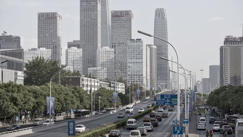 Vehicles travel along a section of the 3rd Ring Road in Beijing.