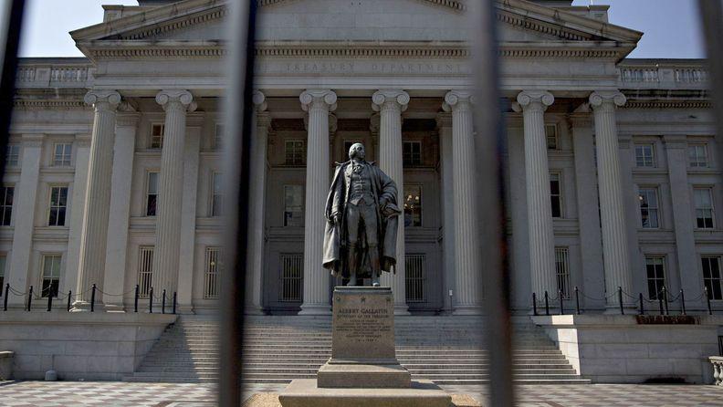 A statue of Albert Gallatin, former U.S. Treasury secretary, stands outside the U.S. Treasury building in Washington.