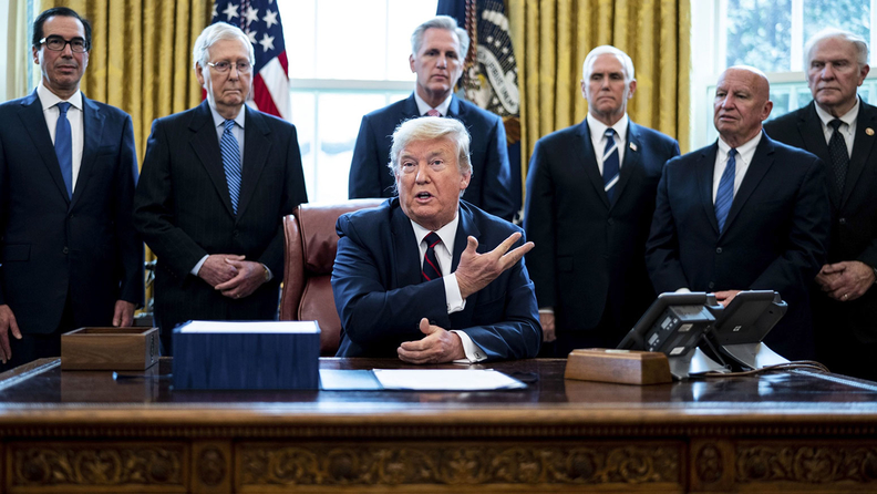 U.S. President Donald Trump speaks before signing the H.R. 748, Coronavirus Aid, Relief, and Economic Security (CARES) Act, in the Oval Office of the White House in Washington, D.C., U.S., on Friday, March 27, 2020.