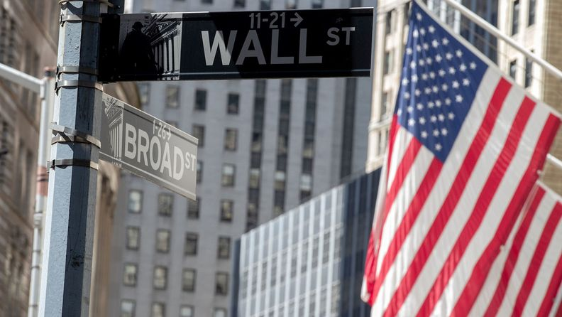 Wall street signage is seen near the New York Stock Exchange (NYSE) in New York, U.S., on Friday, June 12, 2020.